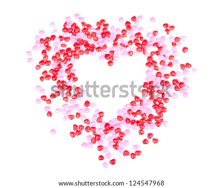 Candy hearts in the shape of a heart on a white background