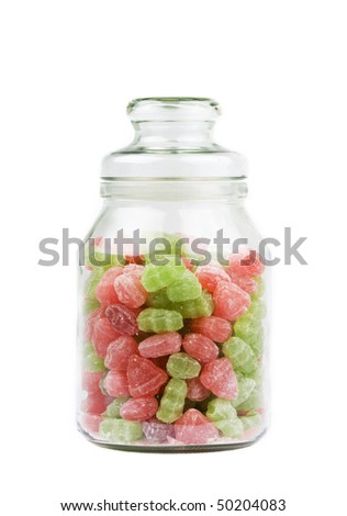 Candy in a glass jar isolated on a white background.