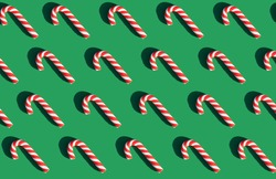 candy lollipops on a green background. graphic pattern. happy new year and christmas