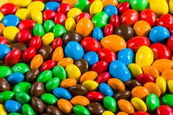 Candy on the yellow background, colorful candy and multicolored gradient