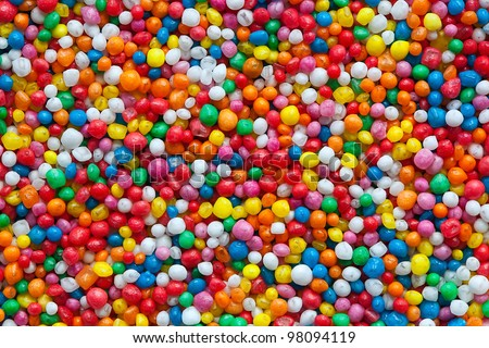 Candy sprinkles, in full-frame background.  Colorful hundreds and thousands or nonpareils.