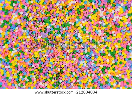 Candy sprinkles used to decorate birthday cakes and other desserts.