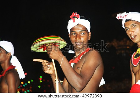 CANDY, SRI LANKA  - AUG 12: artist with fire work is participating the festival Pera Hera in Candy to celebrate the tooth of Buddha  August 12,2005, Candy, Sri Lanka