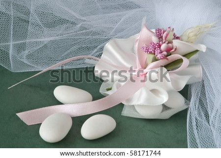 candy wedding favors and packaging materials on a green background