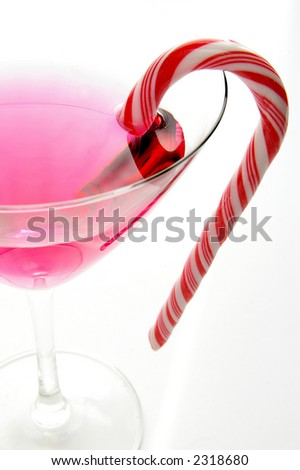 Candycane in a martini glass on white background