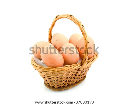 Cane basket filled with chicken eggs isolated on white background