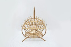 cane magazine rack on the white background selective soft focus, home décor furniture
