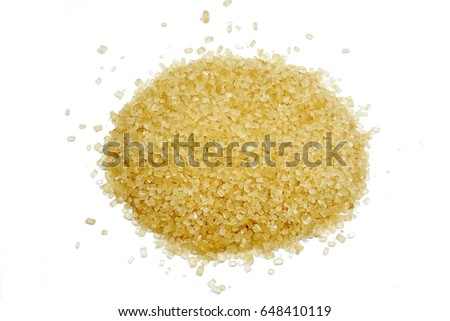cane sugar unrefined, dry demerara isolated on the white background #648410119