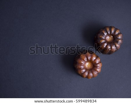 Caneles from Bordeaux isolated on dark background, shot from above #599489834