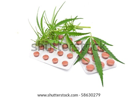 Cannabis leaf with tablets