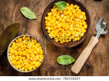Canned corn in a bowl on the board.