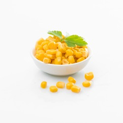Canned corn  in a bowl. sweet corn. corn isolated on white background