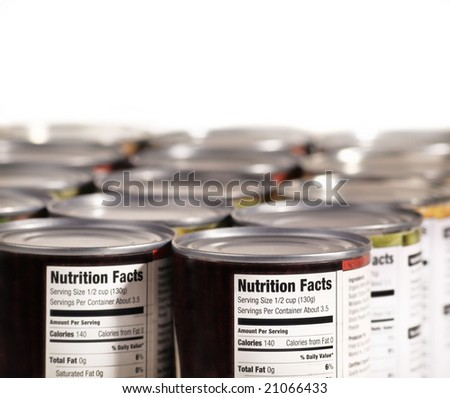 Canned food lined up on shelf with nutrition fact label