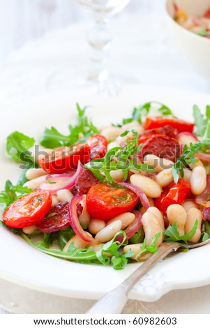 cannellini bean salad with roast cherry tomatoes,chorizo and red onion