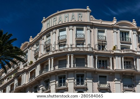 """CANNES, FRANCE - JULY 10, 2014: Luxury hotel """"Le Palais Miramar"""" (1929), located on famous """"La Croisette"""" Boulevard in Cannes, French Riviera. Miramar is one of most prestigious hotel in Cannes. #280584065"""