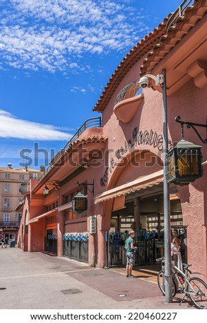 CANNES, FRANCE - JULY 10, 2014: View of market Forville - seasonal produce, local fish and flowers, this large covered market in the heart of the city.