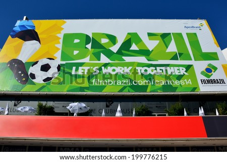 CANNES, FRANCE - JUNE 20: Facade conference hall shown on june 20, 2014 in Cannes, France. Bill-posting realized to celebrate the 2014 FIFA world cup and the Brazil, organizer country.