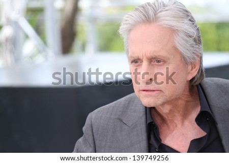 CANNES, FRANCE - MAY 21: Actors Michael Douglas attends the 'Behind The Candelabra' Photocall during The 66th Cannes Film Festival at the Palais des Festivals on May 21, 2013 in Cannes, France.
