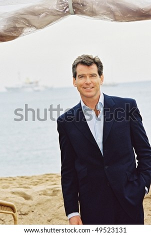 CANNES, FRANCE - MAY 18: British actor Pierce Brosnan, 'James Bond', poses for photographers during a photocall on Cannes beach 18 May 2002 during the 55th Cannes film festival in Cannes, France