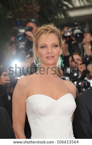 """CANNES, FRANCE - MAY 11, 2011: Cannes Jury member Uma Thurman at the gala premiere for """"Midnight in Paris"""" the opening film at the 64th Festival de Cannes. May 11, 2011  Cannes, France"""