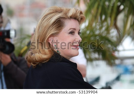 CANNES, FRANCE - MAY 15: Catherine Deneuve attends the 'Homage To The Spanish Cinema' photocall at the Palais des Festivals during the 63rd  Cannes Film Festival on May 15, 2010 in Cannes, France. - stock photo
