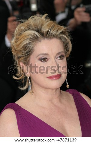 CANNES, FRANCE - MAY 11: Catherine Deneuve attends the 58th Cannes Film Festival Opening Ceremony and premiere of opening film 'Lemming'at the Grand Theatre Lumiere on May 11, 2005 in Cannes, France