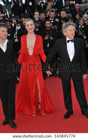"CANNES, FRANCE - MAY 25, 2013: Director Roman Polanski & wife Emmanuelle Seigner & Mathieu Amalric at the gala premiere for their movie ""Venus in Fur"" in competition at the 66th Festival de Cannes."