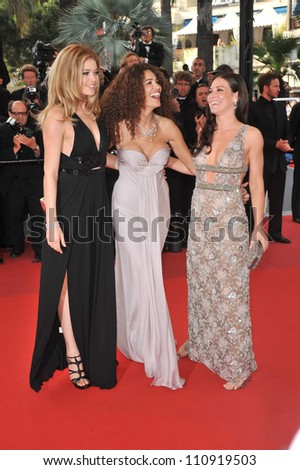 """CANNES, FRANCE - MAY 17, 2009: Doutzen Kroes (left), Afef Jnifen & Evangeline Lilly at the premiere of """"Vengeance"""" in competition at the 62nd Festival de Cannes."""