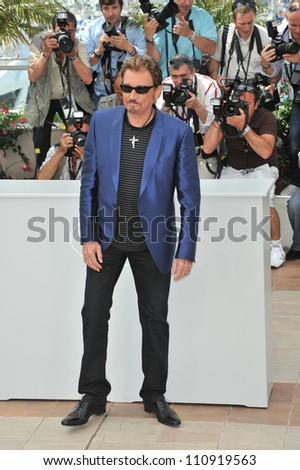 "CANNES, FRANCE - MAY 17, 2009: French superstar Johnny Hallyday at the photocall for his new movie ""Vengeance"""