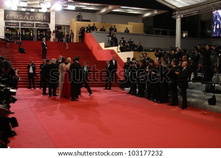 CANNES, FRANCE - MAY 18: Guests walk the carpet for the 'Reality' premiere during the 65th Annual Cannes Film Festival at Palais des Festivals on May 18, 2012 in Cannes, France. - stock photo