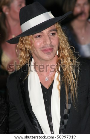 CANNES, FRANCE - MAY 19: John Galliano  arrives at 'Cinema Against AIDS 2005', at Le Moulin de Mougins at the 58th Cannes Film Festival on May 19, 2005 in Cannes, France - stock photo