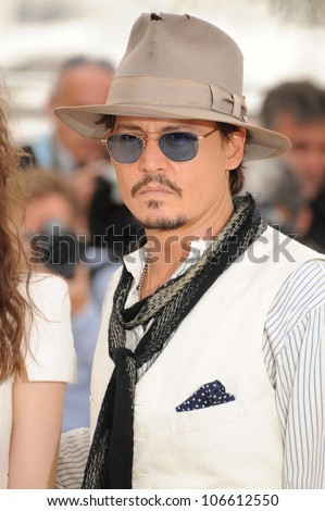 """CANNES, FRANCE - MAY 14, 2011: Johnny Depp at the photocall for his movie """"Pirates of the Caribbean: On Stranger Tides"""" at the 64th Festival de Cannes. May 14, 2011  Cannes, France"""