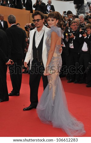 "CANNES, FRANCE - MAY 14, 2011: Johnny Depp & Penelope Cruz at the gala for their movie ""Pirates of the Caribbean: On Stranger Tides"" at the 64th Festival de Cannes. May 14, 2011  Cannes, France"
