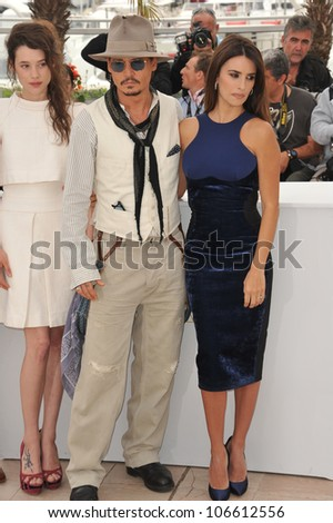 """CANNES, FRANCE - MAY 14, 2011: Johnny Depp & Penelope Cruz at the photocall for their movie """"Pirates of the Caribbean: On Stranger Tides"""" at the 64th Festival de Cannes. May 14, 2011  Cannes, France"""