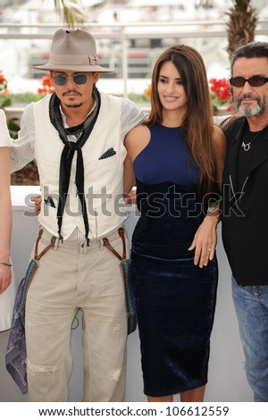 "CANNES, FRANCE - MAY 14, 2011: Johnny Depp & Penelope Cruz at the photocall for their movie ""Pirates of the Caribbean: On Stranger Tides"" at the 64th Festival de Cannes. May 14, 2011  Cannes, France"