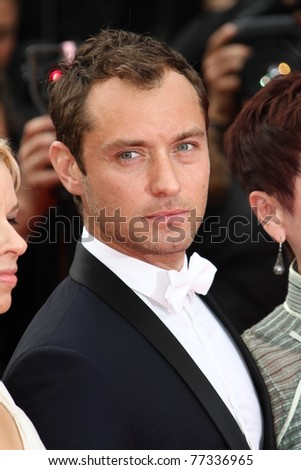 CANNES, FRANCE - MAY 14:   Jude Law attends the 'Pirates of the Caribbean: On Stranger Tides' premiere during the 64th Cannes Film Festival at Palais des Festivals on May 14, 2011 in Cannes, France - stock photo