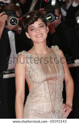 CANNES, FRANCE - MAY 25: Marion Cotillard arrives at the premiere for the film 'We Own The Night' at the Palais des Festivals during the 60 Cannes Film Festival on May 25, 2007 in Cannes, France.