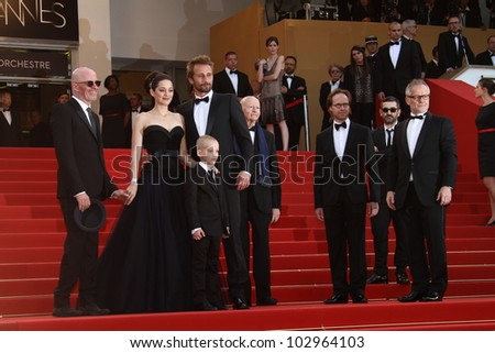 CANNES, FRANCE - MAY 17: Matthias Schoenaerts,  Jacques Audiard, Marion Cotillard  attend the 'De Rouille et D'os' Premiere during the 65th Cannes Festival at Palais on May 17, 2012 in Cannes, France.