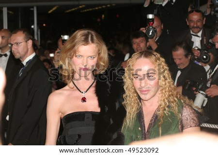 CANNES, FRANCE - MAY 18: Model Eva Herzigova and  designer John Galliano attend the screening of 'Sin City' at the Grand Theatre during the 58 Cannes Film Festival May 18, 2005 in Cannes, France