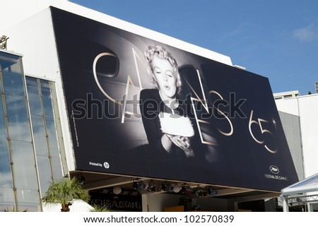CANNES, FRANCE - MAY 15: Palais des Festivals facade shown on May 15, 2012 in Cannes, France. Palais des Festivals with the official poster for the sixty fifth international movie festival.
