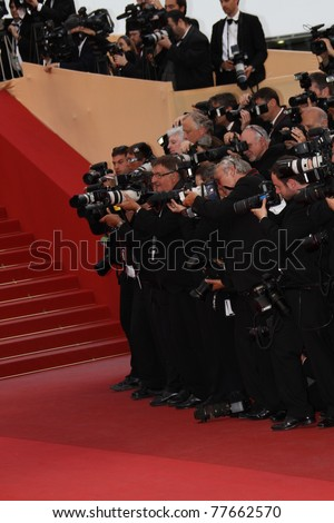 CANNES, FRANCE - MAY 18: Photographer attend the 'La Conquete' premiere during 64th Annual Cannes Film Festival at Palais des Festivals on May 18, 2011 in Cannes, France - stock photo