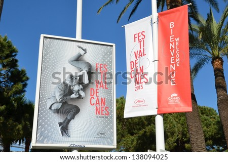 CANNES, FRANCE - MAY 11: Poster advertising shown on May 11, 2013 in Cannes,France. Official poster for the international movie festival 2013 presented on the famous Boulevard Croisette in Cannes.