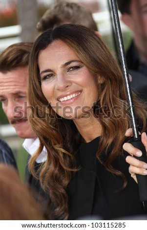 CANNES, FRANCE - MAY 18: Sean Penn, Roberta Armani  pose at the 'Haiti Carnaval In Cannes' photocall during the 65th Annual Cannes Film Festival on May 18, 2012 in Cannes, France.