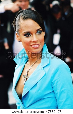 CANNES, FRANCE - MAY 14: Singer Alicia Keys attends the premiere for film 'Zivot Je Cudo' (Life is a Miracle) at The 57th Annual Cannes Film Festival on May 14, 2004 in Cannes, France.