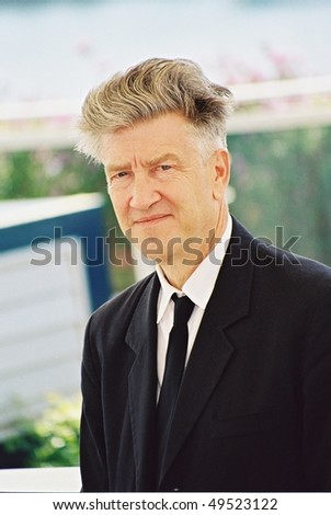 CANNES, FRANCE - MAY 15: The jury's president of the 55th Cannes Film Festival,  David Lynch, poses for photographers during a photocall  of the Palais des festivals May 15,  2002 in Cannes, France