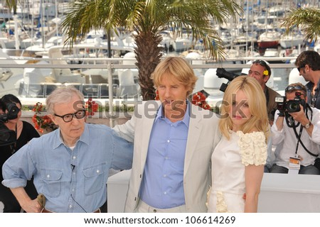 """CANNES, FRANCE - MAY 11, 2011: Woody Allen & Rachel McAdams & Owen Wilson at the photocall for their new movie """"Midnight in Paris"""" at the 64th Festival de Cannes. May 11, 2011  Cannes, France"""
