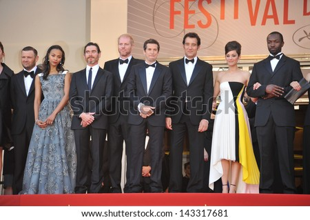 "CANNES, FRANCE - MAY 20, 2013: Zoe Saldana, Marion Cotillard, Billy Crudup, James Caan, Noah Emmerich & director Guillaume Canet at the gala premiere of ""Blood Ties"" at the 66th Festival de Cannes."