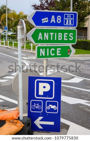 Cannes, France, 8th April 2018: Road signs outside Nice airport direct traffic Towards the A8 highway, and in the direction of Nice and Antibes on the Cote d Azur.