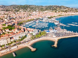 Cannes port and beach aerial panoramic view. Cannes is a city located on the French Riviera or Cote d'Azur in France.
