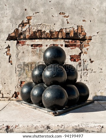Cannon balls against exterior wall of Fort Zachary Taylor in Key West, Florida